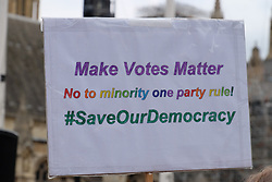 June 24, 2017 - London, England, United Kingdom - A placard is held up in front of Parliament. The Make votes matter group, calling for a change in the voting system to give smaller parties more seats in Parliament holds a rally outside Parliament in London, UK, on 24 June 2017. (Credit Image: © Jay Shaw Baker/NurPhoto via ZUMA Press)