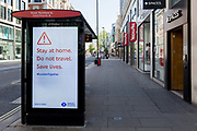 At the beginning of the fourth week of the UK governments lockdown during the Coronavirus pandemic, and with 120,067 UK reported cases with 16,060 deaths, a digital ad telling Londoners to stay at home is displayed on Oxford Street that would normally be a busy thoroughfare for shoppers and traffic and which remains largely deserted at mid-day, on 20th April 2020, in London, England.