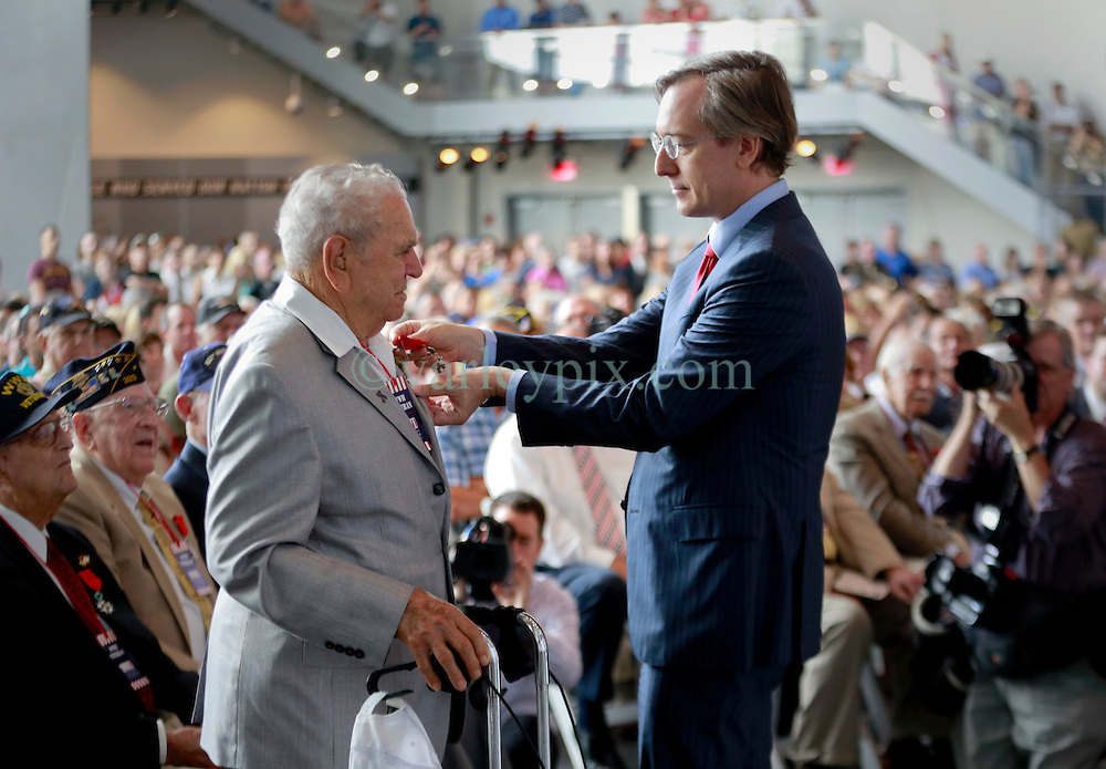 06 June 2014. The National WWII Museum, New Orleans, Lousiana. <br /> WWII veteran Pfc Placid Tamporello, 9th Division, 47th Infantry is honored with the French Legion of Honor medal by French Consul General, Claude Brunet..<br /> Photo; Charlie Varley/varleypix.com