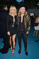 ELLIE GOULDING and DOUGIE POYNTER at the Glamour Women of The Year Awards held in Berkeley Square, London on 2nd June 2015.