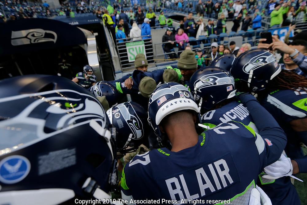 Seattle Seahawks defensive back Marquise Blair joins teammates in a huddle before an NFL football game against the Tampa Bay Buccaneers, Sunday, Nov. 3, 2019, in Seattle. (AP Photo/John Froschauer)