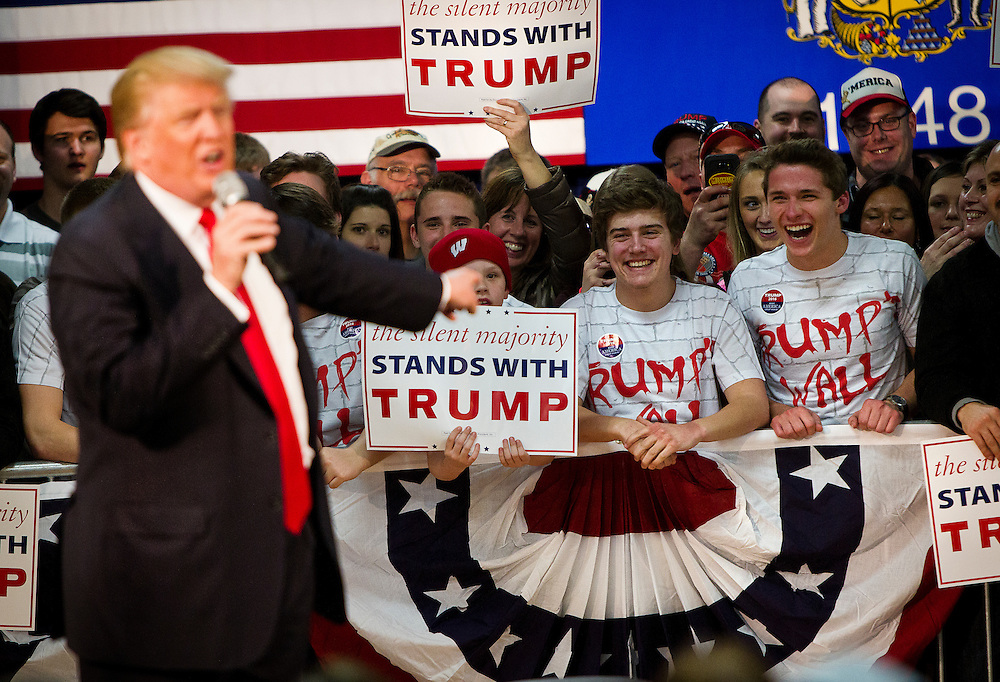 Republican U.S. presidential candidate Donald Trump points to a group of young Trump supporters in the crowd at a campaign town hall event in Wausau, Wisconsin April 2, 2016.   REUTERS/Ben Brewer