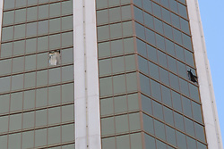 Photos of the broken windows on the 32nd of the Mandalay Bay Casino were the gunman from last nights massacre in Las Vegas shot from. Also there are photos of every blackjack, craps, roulette and all gaming tables were closed inside the casino. 02 Oct 2017 Pictured: Mandalay Bay. Photo credit: MEGA TheMegaAgency.com +1 888 505 6342