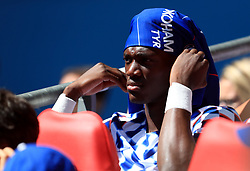 """Chelsea's Tammy Abraham shelters from the sun on the bench during the Community Shield match at Wembley Stadium, London. PRESS ASSOCIATION Photo. Picture date: Sunday August 5, 2018. See PA story SOCCER Community Shield. Photo credit should read: Mike Egerton/PA Wire. RESTRICTIONS: EDITORIAL USE ONLY No use with unauthorised audio, video, data, fixture lists, club/league logos or """"live"""" services. Online in-match use limited to 75 images, no video emulation. No use in betting, games or single club/league/player publications."""
