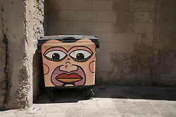 Woman face painted on garbage bin, Puglia, Italy