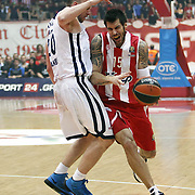 Olympiacos's Georgios Printezis (R) and Anadolu Efes's Dusko Savanovic (L) during their Turkish Airlines Euroleague Basketball playoffs Game 5 Olympiacos between Anadolu Efes at SEF Indoor Hall in Piraeus, in Greece, Friday, April 26, 2013. Photo by TURKPIX