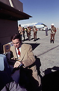 Sam Donaldson types a report on the tarmac in Cairo Egypt in January 1978 on a carter presidential visit to Egypt..Photograph by Dennis Brack BBBs 20