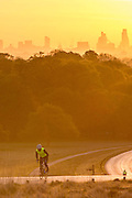 UNITED KINGDOM, London: 05 May 2016 A cyclist makes his way through Richmond Park in front of a London skyline this morning on yet another warm day. Temperatures are set to increase through to the weekend, reaching up to 25 degrees. Rick Findler / Story Picture Agency