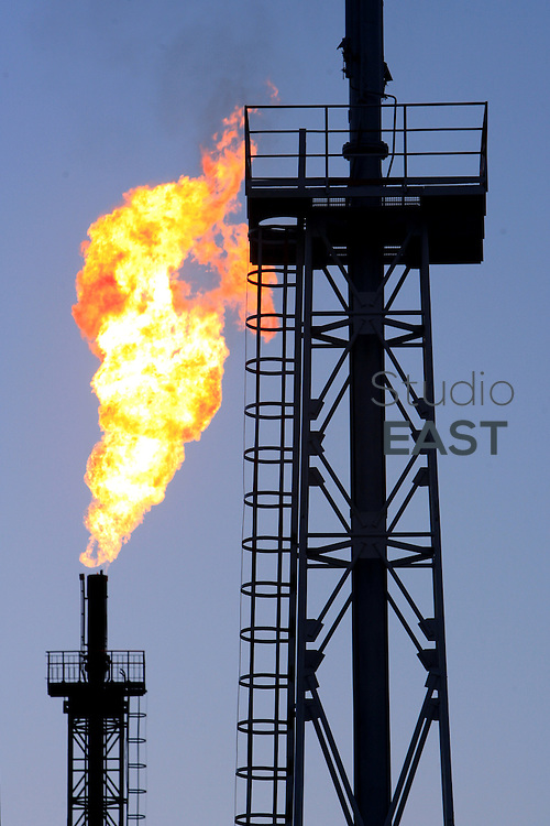 XINJIANG PROVINCE, CHINA - October 12: Unused gas burns out of a flare bleeder in Petrochina's Tazhong oil factory on October 12, 2006 in Tarim Oilfield, Xinjiang province, China. PetroChina went public on the Shanghai Stock Exchange Monday, Nov. 5, and the shares nearly tripled the same day. At US$1.005 trillion market capital, PetroChina is now the only trillion-dollar company in the world, twice the value of its US peer Exxon Mobil. (Photo by Servais Mont/Getty Images)