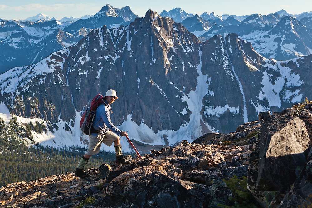 Kevin Steffa hikes up Golden Horn, Okanogan National Forest, Washington. Mount Hardy rises prominently across the valley.