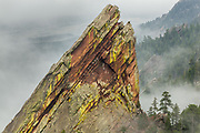 The Third Flatiron (seen from the First Flatiron) rises from the mist above Boulder, Colorado.