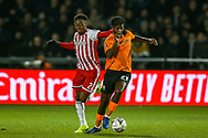 Barnet midfielder Medy Elito (21) is fouled by Brentford defender Moses Odubajo (2) during the The FA Cup fourth round match between Barnet and Brentford at The Hive Stadium, London, England on 28 January 2019.