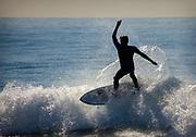 A Man Surfing Waves In Huntington Beach California