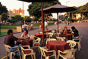 PERU, LIMA, MIRAFLORES SUBURB Parque Central, popular gathering spot in busy suburb with upscale banks, shops, homes and sidewalk cafes