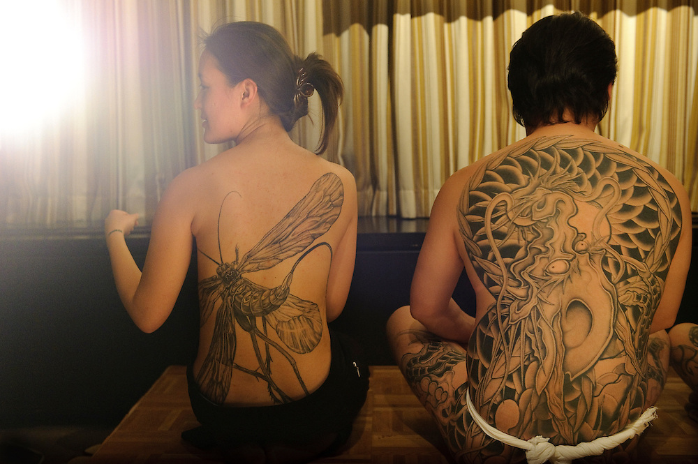 """Models displaying tattoos by Horimyo.Tattoo demonstration, FCCJ, 25 Feb 2009. Author Manami Okazaki and photographer Martin Hladik introduce their book: """"Tattoo in Japan"""" while tattoo master Horimyo gives a demonstration of his art."""