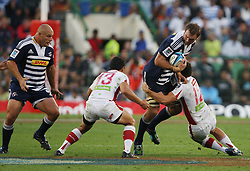 Andries Bekker of the Stormers is tackled by Mike Harris of the Reds during the Super Rugby (Super 15) fixture between DHL Stormers and the Reds played at DHL Newlands in Cape Town, South Africa on 9 April 2011. Photo by Jacques Rossouw/SPORTZPICS