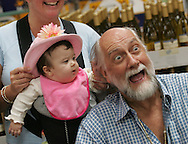 Mick Fleetwood has some fun with six-month-old Kristy Riddle of Corona Del Mar during a promotional stop at Costco in Fountain Valley promoting his new Mick Fleetwood Private Cellar wines.