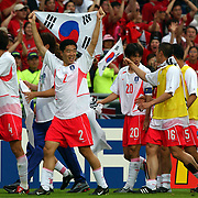 Republic of Korea's players on a lap of honour after their victory over Spain