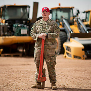 U.S. Air Force Tech. Sgt. Paul Waters, a vehicle maintenance NCOIC with the 823 Expeditionary RED HORSE Squadron, maintains the squadron's construction equipment. Sgt Waters and his team battle the harsh environment that frequently breaks their equipment. (U.S. Air Force photo by Tech. Sgt. Perry Aston)