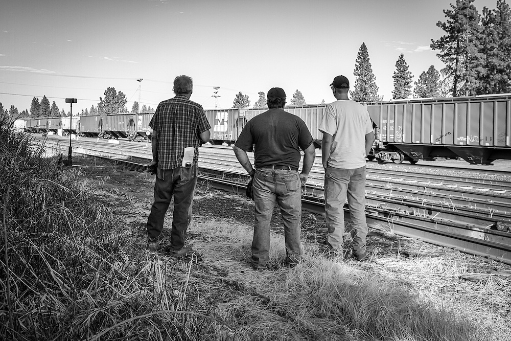 At the BNSF interchange in Cheney, WA, the road crew of the Eastern Washington Gateway train watch the arrival of an incoming train of empty hopper cars which they will take down their line for loading.