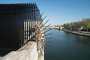 """April, 4th 2020 - Paris, Ile-de-France, France: Latin Quarter, love padlocks on bridge over seine during the first month of near total lockdown imposed in France. A week after President of France, Emmanuel Macron, said the citizens must stay at home for at least 15 days, that has been extended. He said """"We are at war, a public health war, certainly but we are at war, against an invisible and elusive enemy"""". All journeys outside the home unless justified for essential professional or health reasons are outlawed. Anyone flouting the new regulations is fined. Nigel Dickinson"""