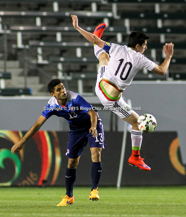 United States' Jorge Villafana #13 and Mexico's Marco Bueno #10 fight for a ball during a men's national team international friendly match, April 22, 2015, at StubHub Center in Carson, California. United States won 3-0. (Photo by Ringo Chiu/PHOTOFORMULA.com)