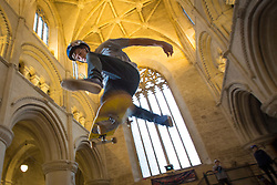 "© Licensed to London News Pictures 14/02/2018, Malmesbury, UK. LDave Read from Peterborough gets some jumps in at the 10th anniversary of ""Malmesbury Skate"", a skating festival that is set up inside Malmesbury Abbey (a former Benedictine Abbey) during school half term.Photo Credit : Stephen Shepherd/LNP"