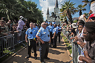 Sept. 24, New Orleans, Police guard a statue of Andrew Jackson in Jackson Square from activists taking part in a protest organized by 'Take Em Down NOLA'. The group threatened to topple the statue, in response to the city not removing four statues of Confederate figures in New Orleans. Former Ku Klux Klan leader and current U.S. Senate candidate David Duke came to the park to show his support for the  Confederate statues, but left before the protesters arrived.