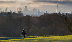"""A man walks across Hampstead Heath. The threatened snow from """"The Beast From The East"""" weather system doesn't materialise overnight in London leaving a crisp, clear morning, seen from Hampstead Heath in North London. London, February 27 2018."""