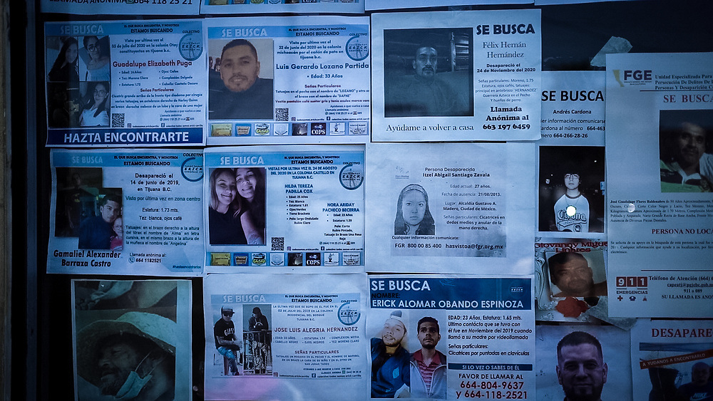 Missing people posters are found across Tijuana, as thousands of migrants disappear each year. Some die on their journey across Mexico, drowned in rivers, or of dehydration in deserts, or in the many accidents on freight trains but many are killed by organised crime groups when they are kidnapped and ransom money isn't paid. Sex-related murder of women, known as femicides, is also common.