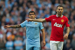 MANCHESTER, ENGLAND - Monday, April 30, 2012: Manchester City's Carlos Tevez and Manchester United's Ryan Giggs during the Premiership match at the City of Manchester Stadium. (Pic by David Rawcliffe/Propaganda)