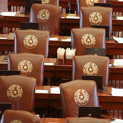 Images from 2003's Democratic walkout in the Texas House from May 12-13, 2003 during the 78th session of the Texas Legislature include empty chairs in the House chamber.