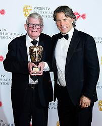John Motson with his Bafta special award alongside John Bishop (right) in the press room at the Virgin TV British Academy Television Awards 2018 held at the Royal Festival Hall, Southbank Centre, London.