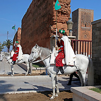 Africa, Morocco, Rabat. Guards on horses at Hassan Tower Gate.