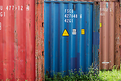 30 May 2014:   a short row of cargo shipping containers
