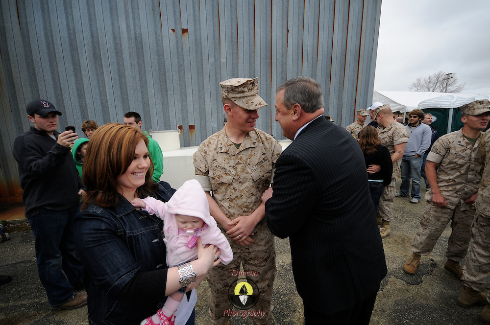 5/5/11 -- TOPSHAM, Maine.  Maine Gov. Paul LePage right, greets U.S. Marine Lance Cpl Andrew Arseneau of Bucksport while his wife, Jasmine and seven-month old daughter Arianna stand by. U.S. Marine Reservists departed from Topsham on Thursday for the start of a year-long deployment to Afghanistan amidst a crowd of family, friends and well-wishers. This mission will be different from others, said several Marines, because instead of doing combat operations they will be teaching the Afghan National Army to operate independently. They travel first to California for several months of training and are planning to return in May 2012. Photo by Roger S. Duncan.