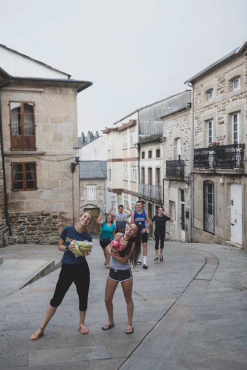 Sarria, Spain - July 6, 2018: Spanish students walking the Camino return to their albergue with a few groceries in the town of Sarria