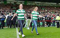24/05/15 SCOTTISH PREMIERSHIP<br /> CELTIC v INVERNESS CT<br /> CELTIC PARK - GLASGOW<br /> Thile (left) and Live Deila, daughters of Celtic manager Ronny Deila bring the Scottish Premiership trophy onto the park