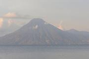 Volcan San Pedro 3020m in the early morning across Lake Atitlan from Panajachel.  The town of San Pedro la Laguna can be seen on the right. Panajachel, Republic of Guatemala. 04Mar14.