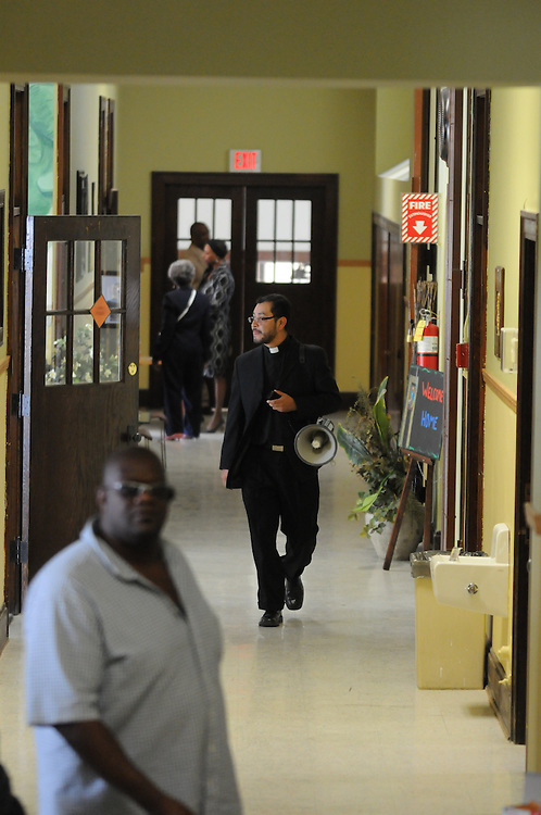 St. Eulalia Pastor Carmelo Mendez roams the halls of the newly-inaugurated Quinn Community Center during an open-house in Maywood. Mendez took the initiative to reopen one of his church's underutilized buildings, formerly the parish school, now renamed for former St. Eulalia Pastor William Quinn and open as a vital component to Carmelo's surrounding community. Quinn made a lasting history for himself as a pioneer for social justice, both in the fields of civil rights, along with those of immigrants in the U.S. He died in 2004.