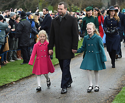 Peter Phillips with his daughters Isla (left) and Savannah arriving to attend the Christmas Day morning church service at St Mary Magdalene Church in Sandringham, Norfolk.