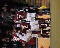 Photo: Ian Hebden.<br />Northampton Town v Rushden & Diamonds. Coca Cola League 2. 04/02/2006.<br />Goalscorer Scott McGleish is mobbed by team-mates after scoring.