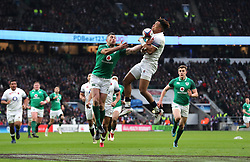 Ireland's Rob Kearney (left) and England's Anthony Watson (right) during the NatWest 6 Nations match at Twickenham Stadium, London.