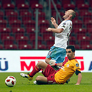 Galatasaray's Arda TURAN (F) and Trabzonspor's Serkan BALCI (B) during their Turkish superleague soccer derby match Galatasaray between Trabzonspor at the TT Arena in Istanbul Turkey on Sunday, 10 April 2011. Photo by TURKPIX