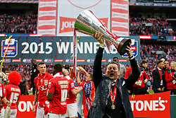 A Champagne drenched Bristol City Manager Steve Cotterill lifts the Football League Trophy after thay win the match 2-0 - Photo mandatory by-line: Rogan Thomson/JMP - 07966 386802 - 22/03/2015 - SPORT - FOOTBALL - London, England - Wembley Stadium - Bristol City v Walsall - Johnstone's Paint Trophy Final.