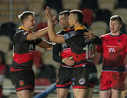 Dragons' Zane Kirchner celebrates scoring his sides third try with Jarryd Sage and Charlie Davies.<br /> <br /> Photographer Simon Latham/Replay Images<br /> <br /> Anglo-Welsh Cup Round Round 4 - Dragons v Worcester Warriors - Friday 2nd February 2018 - Rodney Parade - Newport<br /> <br /> World Copyright © Replay Images . All rights reserved. info@replayimages.co.uk - http://replayimages.co.uk