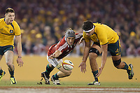 MELBOURNE, 29 JUNE - Jonathan DAVIES of the Lions fights for the ball during the Second Test match between the Australian Wallabies and the British & Irish Lions at Etihad Stadium on 29 June 2013 in Melbourne, Australia. (Photo Sydney Low / asteriskimages.com)