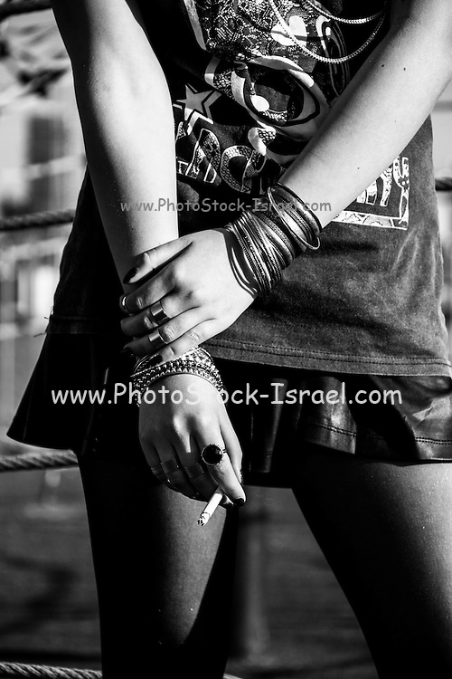 Young female teen clubber with a cigarette