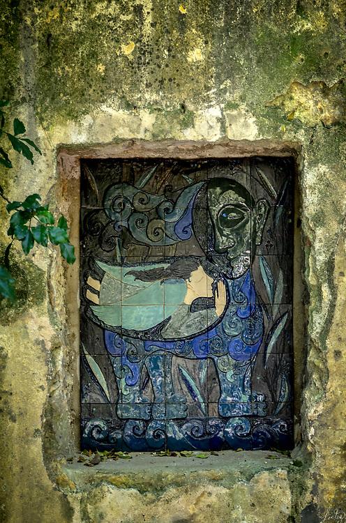 An angel tile embedded in a wall in the biologic garden in Lisbon, Portugal