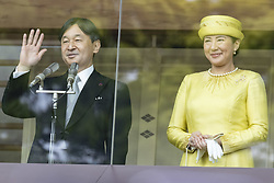 May 4, 2019 - Tokyo, Japan - (L to R) Japan's EMPEROR NARUHITO and EMPRESS MASAKO greet from the balcony to people during their first public greeting at the Imperial Palace. The imperial family appeared to greet well-wishers for the first time after Naruhito became the 126th emperor of Japan on May 1st. (Credit Image: © Rodrigo Reyes Marin/ZUMA Wire)